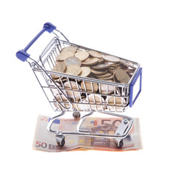 Shopping cart Euro notes and euro coins isolated on white