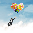 Businesswoman with colorful balloons