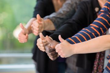 Multiethnic University Students Gesturing Thumbsup