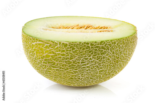 fresh yellow melon in half over white background