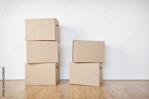 Moving Boxes in an Empty Room - 61308640