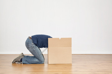 Woman Unpacking a Moving Box