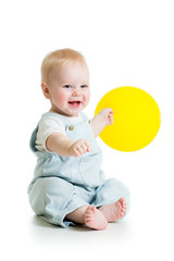 Smiling baby boy  with yellow ballon in his hand isolated on whi