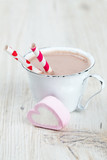 hot chocolate and heart-shaped marshmallow on wooden surface