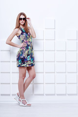 beautiful young woman in short colorful dress