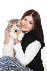 Portrait of a beautiful young woman and a large cat,on white