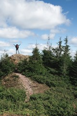 Man rejoices on the top of the hill