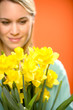 Woman with spring yellow flower narcissus