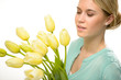 Woman looking down yellow tulip spring flowers