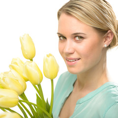 Blond woman with yellow tulips spring flowers