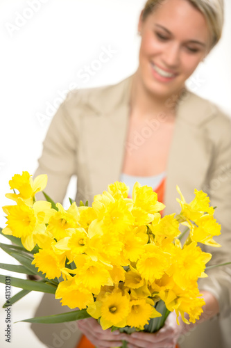 Yellow spring narcissus woman in background