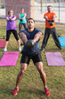 Strong Man Leading Kettle Bell Training