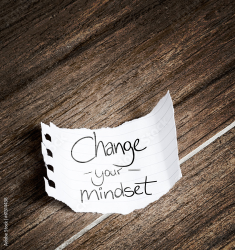 Change your Mindset written on the paper on a wood background