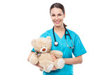 Doctor holding teddy bear