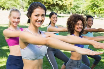 Fit women stretching in park