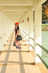 Beautiful Asian Girl pick her bag go travel
