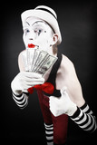 theatrical mime with dollars in their hands