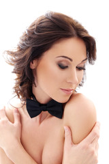 Attractive, cute woman with a bow tie