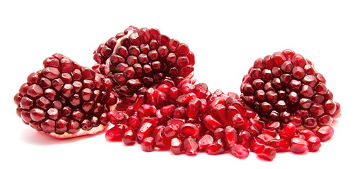 Ripe pomegranate fruit seeds isolated on a white