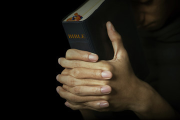 Man holds his bible