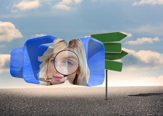 Composite image of blonde holding magnifying glass on abstract s
