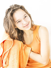 girl after shower wipes hair towel