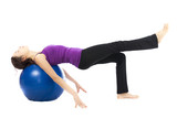Young woman doing pilates ball exercises