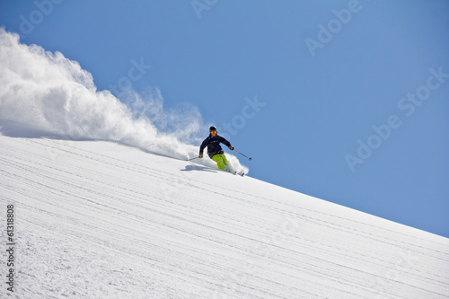 Skier in deep powder, extreme freeride