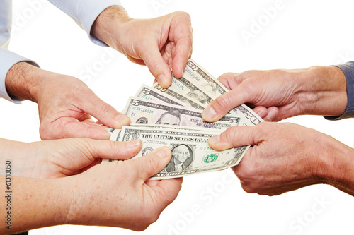 Many hands of senior people holding money