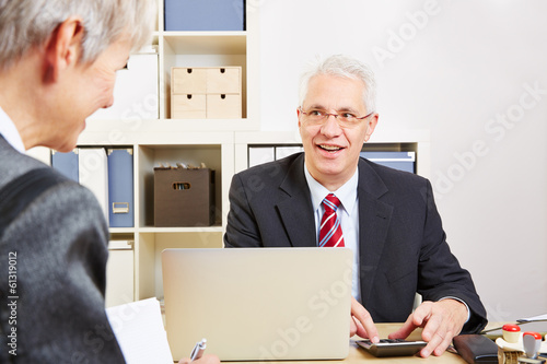 Consultant in bank calculating finances