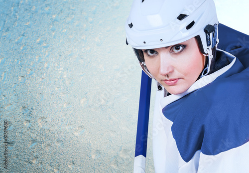 Ice hockey female player fashion portrait ice background