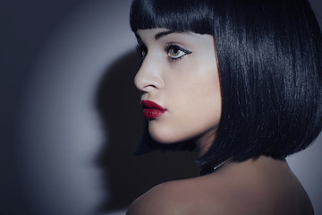 Beautiful Brunette Woman.Retro Haircut.Red lips.Beauty & Fashion