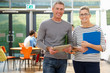 Leinwanddruck Bild - Portrait Of Male And Female Tutors In Classroom