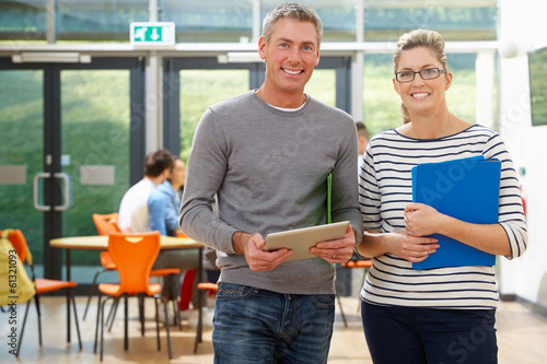 Leinwandbild Motiv Portrait Of Male And Female Tutors In Classroom