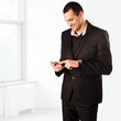 Young smiling businessman with mobile phone