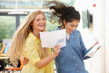 Two Teenage Pupils Celebrating Successful Exam Result