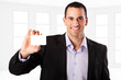 Young businessman with visit card