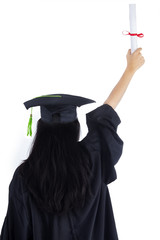 Woman in graduation gown celebrating success