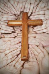 Wooden cross in the hands