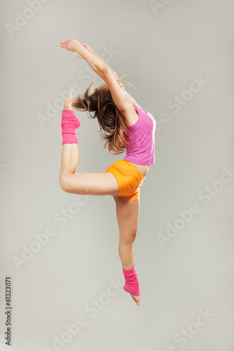 modern dancer poses in front of gray background