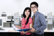 Young business partners at workplace