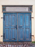 Old blue antique wooden door with padlock.