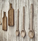 Vintage stylized photo of cutting boards and wooden spoons hangi