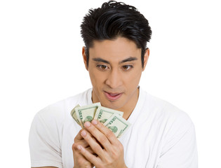 Greedy man looking at dollar bills