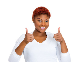 Happy, smiling woman giving thumbs up sign
