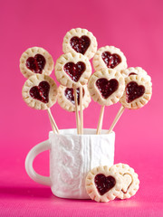 Cookie pop decorated with heart, selective focus