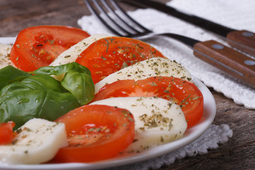 classic caprese salad  on an old wooden table. close up