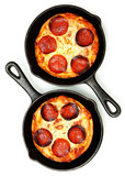 Two Single Serve Skillet Peperonni Pizzas Over White
