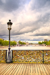 Love padlocks on Pont des Arts bridge, Seine river in Paris, Fra