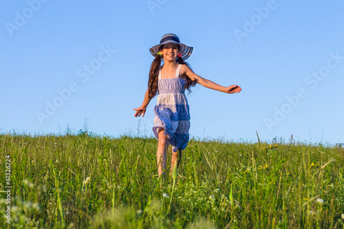 girl running on the green field